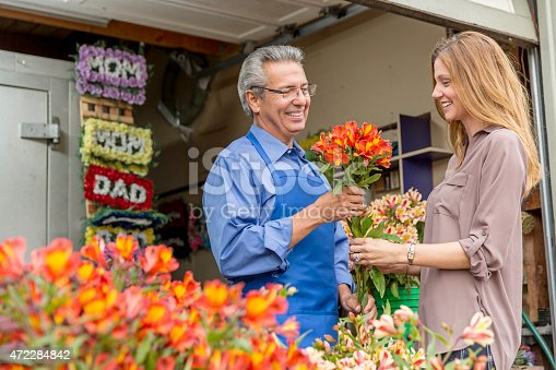 istock Open for Business: Hispanic Small Business Flower Shop Owner 472284842