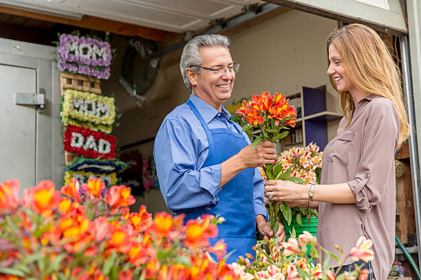 Open for Business: Hispanic Small Business Flower Shop Owner stock photo