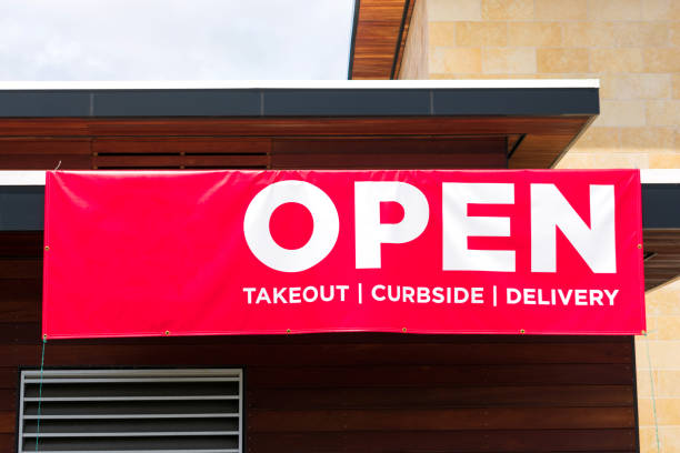 Open for takeout, curbside and delivery outdoor advertisement banner Open for takeout, curbside and delivery outdoor advertisement banner for restaurant. curbsidepickup stock pictures, royalty-free photos & images