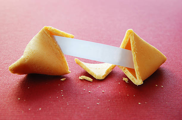 Open fortune cookie with blank fortune stock photo