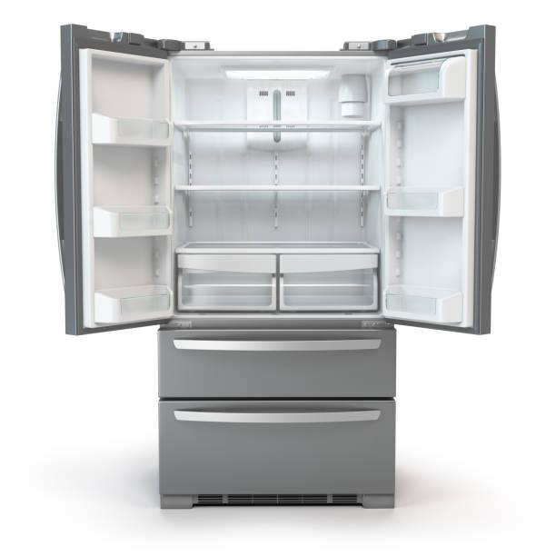 Open fridge freezer. Side by side stainless steel srefrigerator  isolated on white background. stock photo