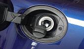 istock Open fuel tank door on car for fueling gasoline or diesel open 1270406938