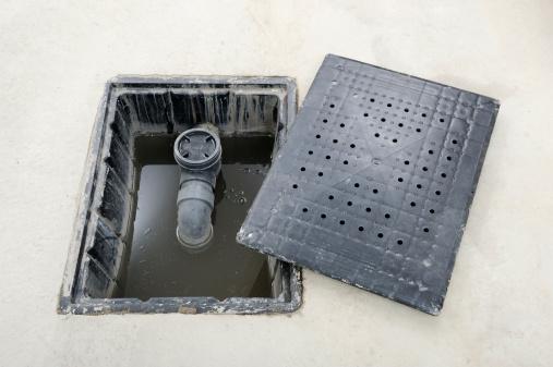 Open Garage Floor Drain Stock Photo - Download Image Now
