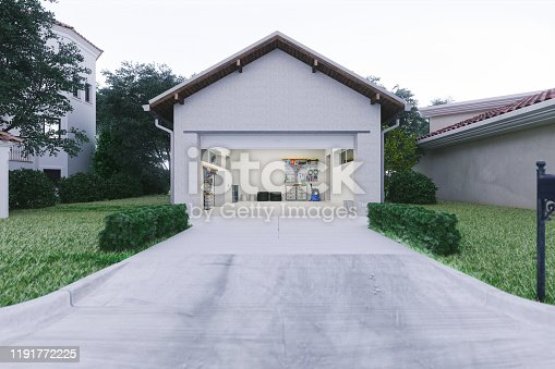 Open door of a modern garage with a concrete driveway at the urban district.