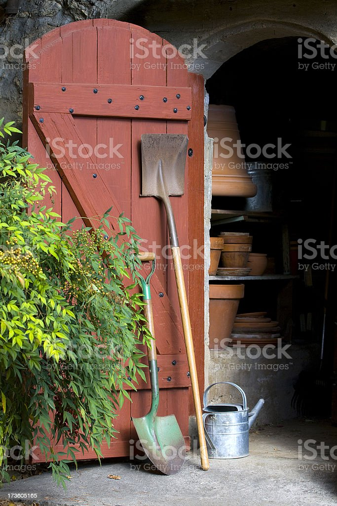 Open garden shed door with tools royalty-free stock photo