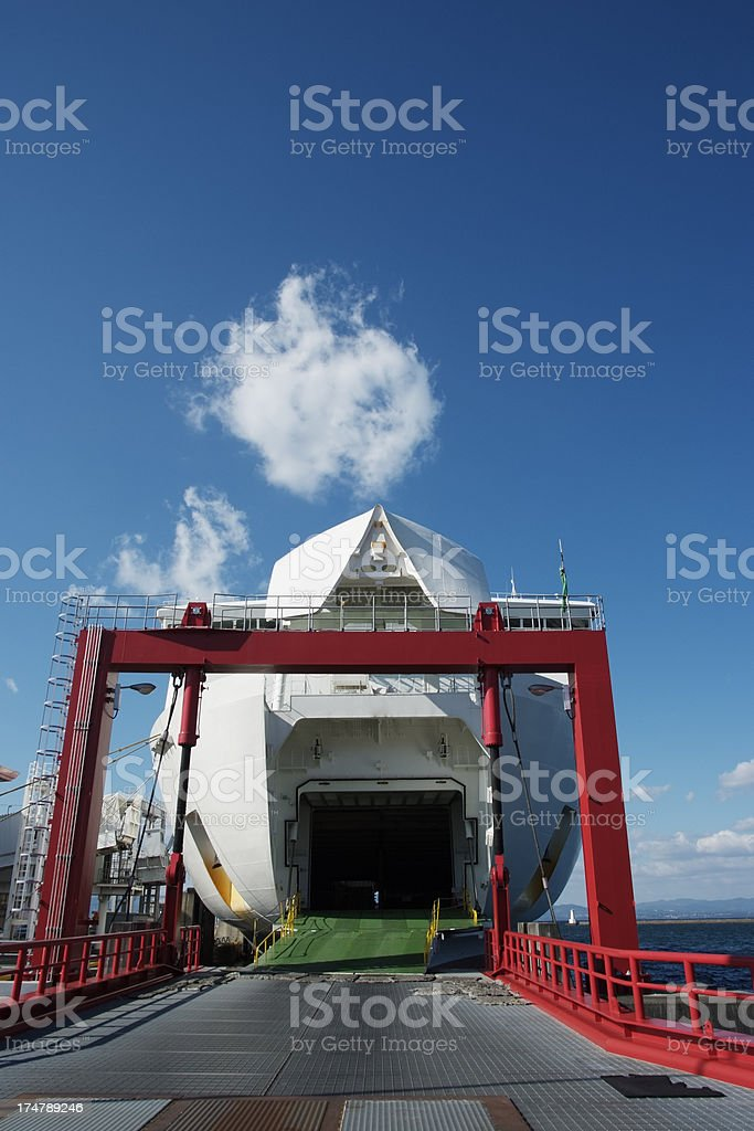 Open gate of ferry against clear sky with copy space royalty-free stock photo