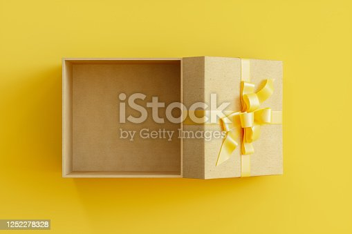 Gift box symbol drawn by purple neon light on black wall. Horizontal composition with copy space.