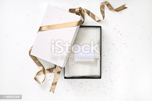 Open gift box with gift tag bow isolated on white background(with clipping path)