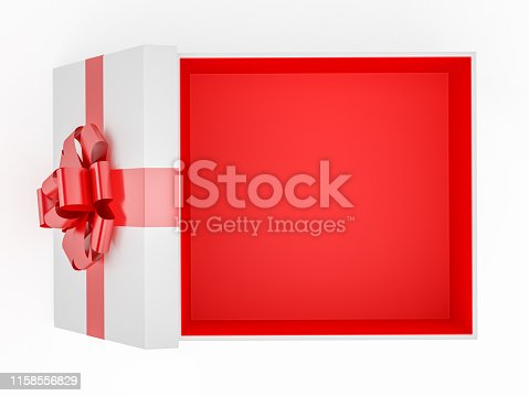 istock Open Gift Box With Red Ribbon Overhead View 1158556829