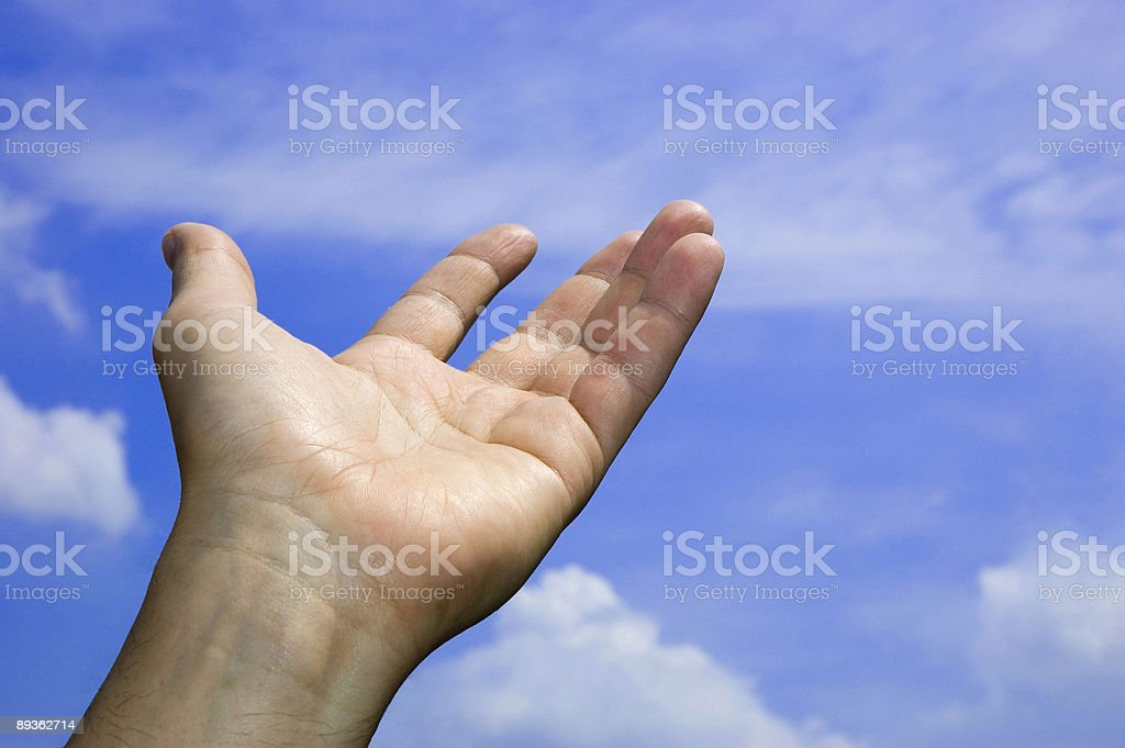 Open hand in the blue sky royalty-free stock photo
