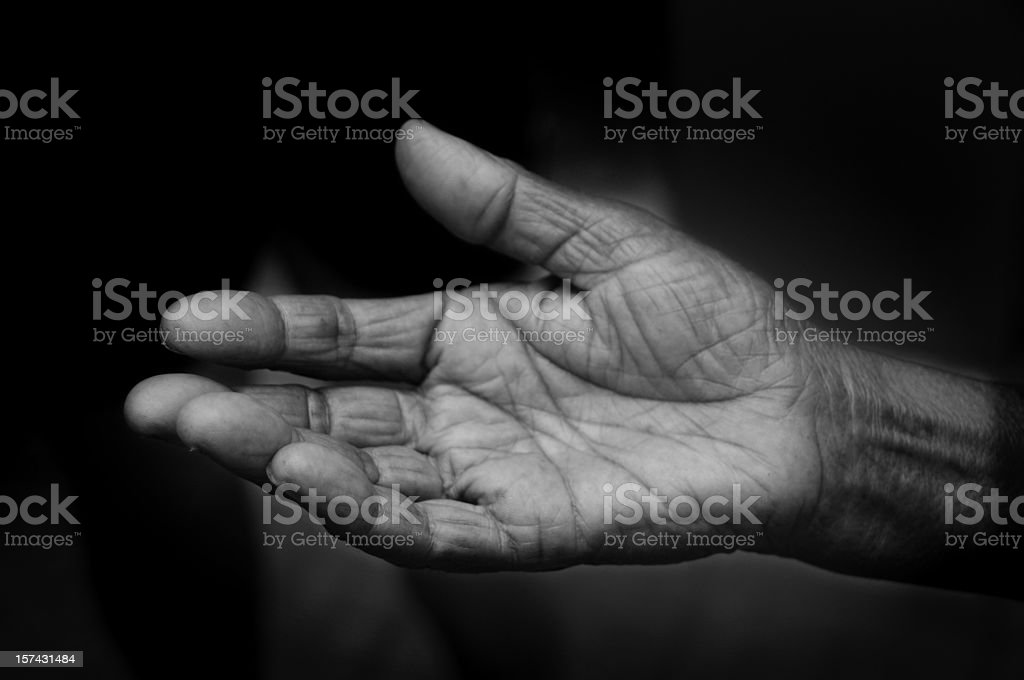 Open hand pleading for help stock photo
