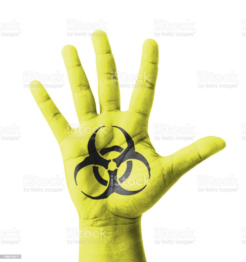 Open hand raised, Biohazard sign painted stock photo