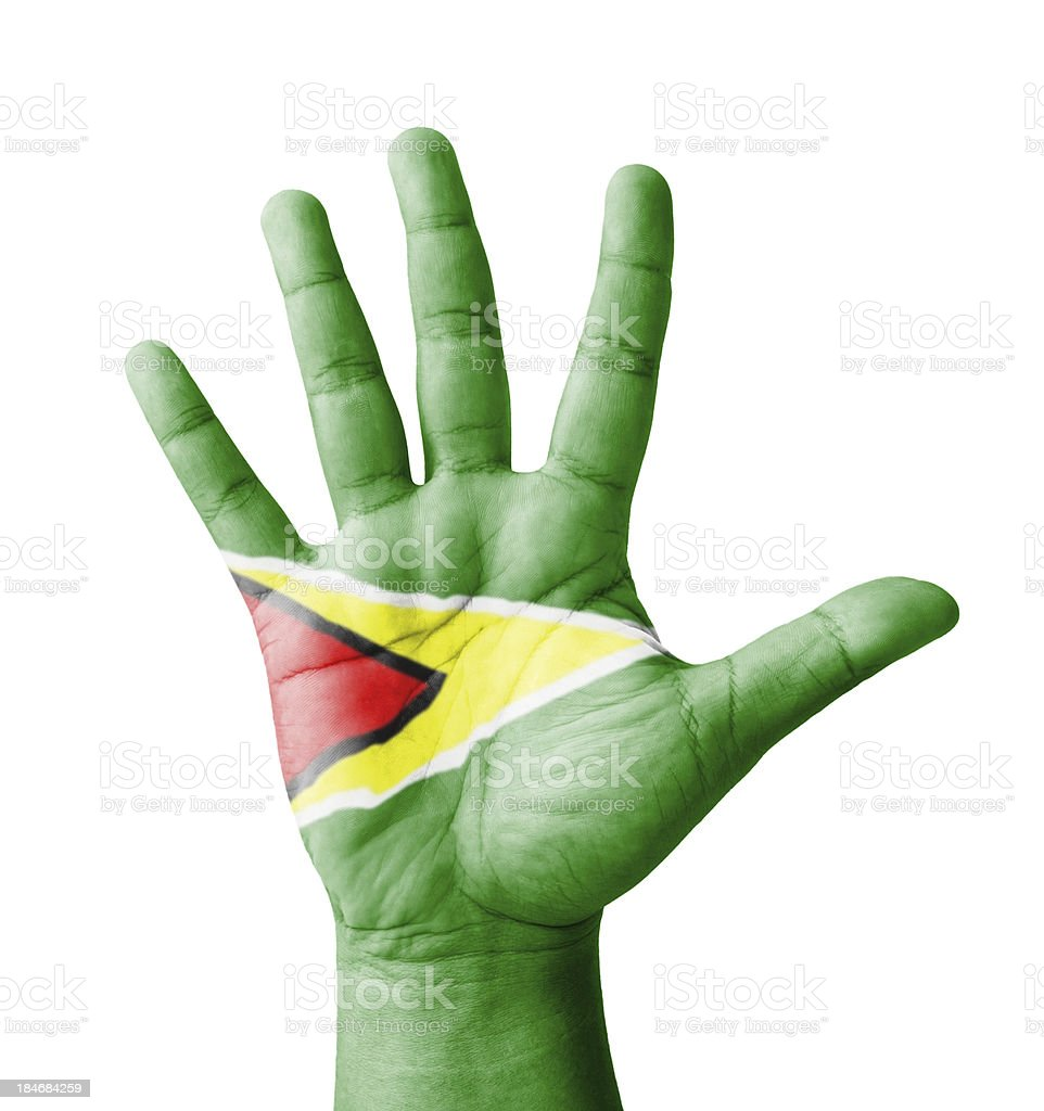 Open hand raised, multi purpose concept, Guyana flag painted royalty-free stock photo
