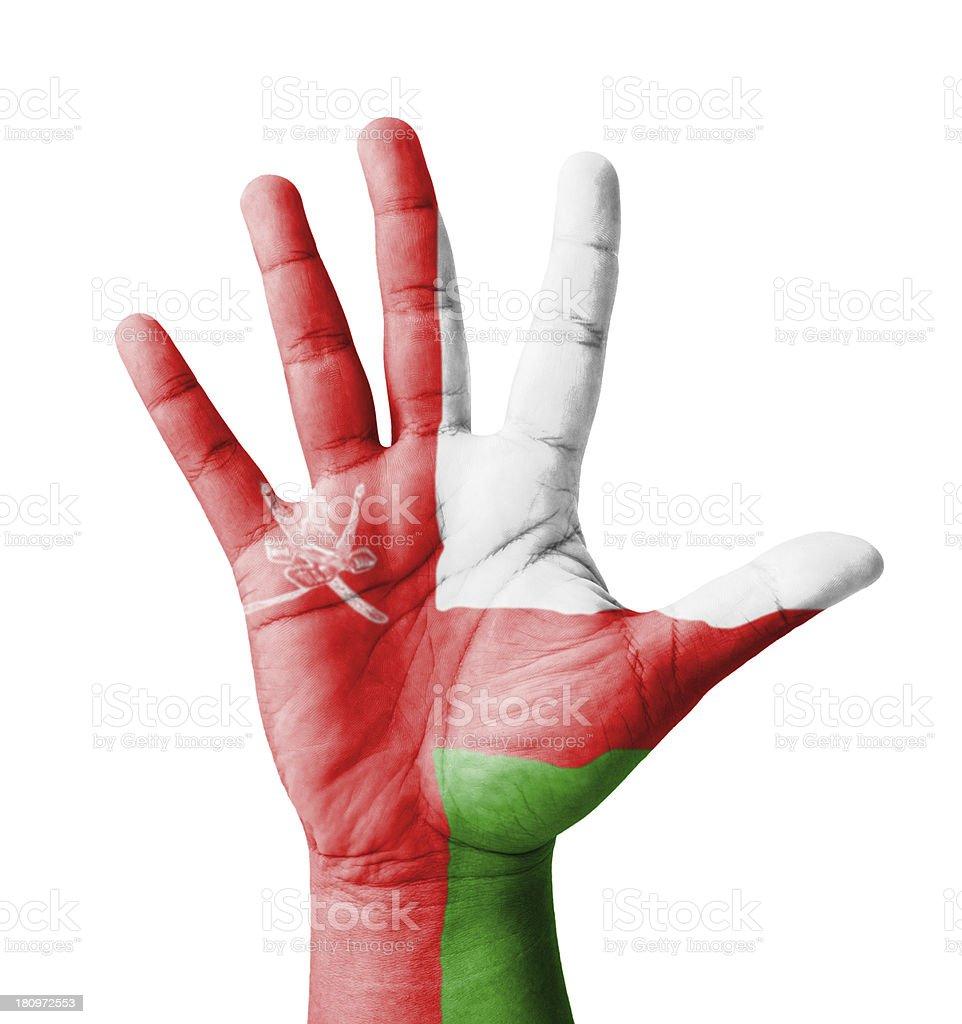 Open hand raised, multi purpose concept, Oman flag painted stock photo