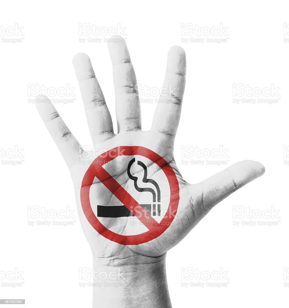 Open hand raised, No Smoking sign painted stock photo