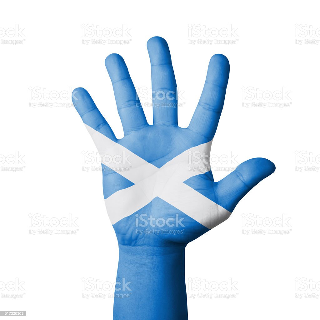 Open hand raised, Scotland flag painted stock photo