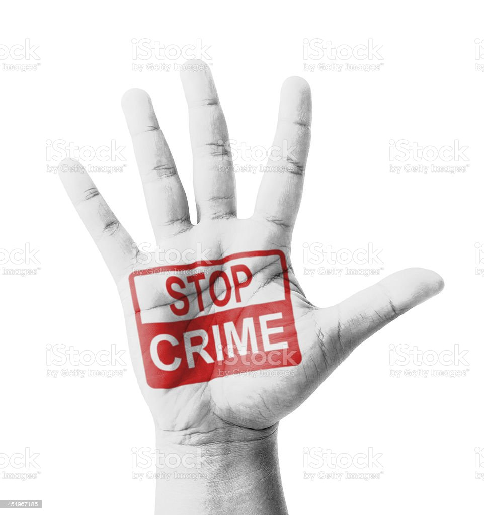 Open hand raised, Stop Crime sign painted stock photo