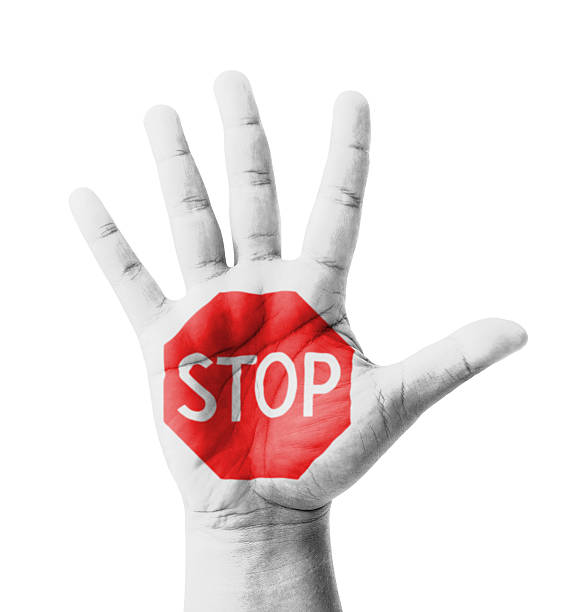 Open hand raised, STOP sign painted Open hand raised, STOP sign painted, multi purpose concept - isolated on white background stop single word stock pictures, royalty-free photos & images