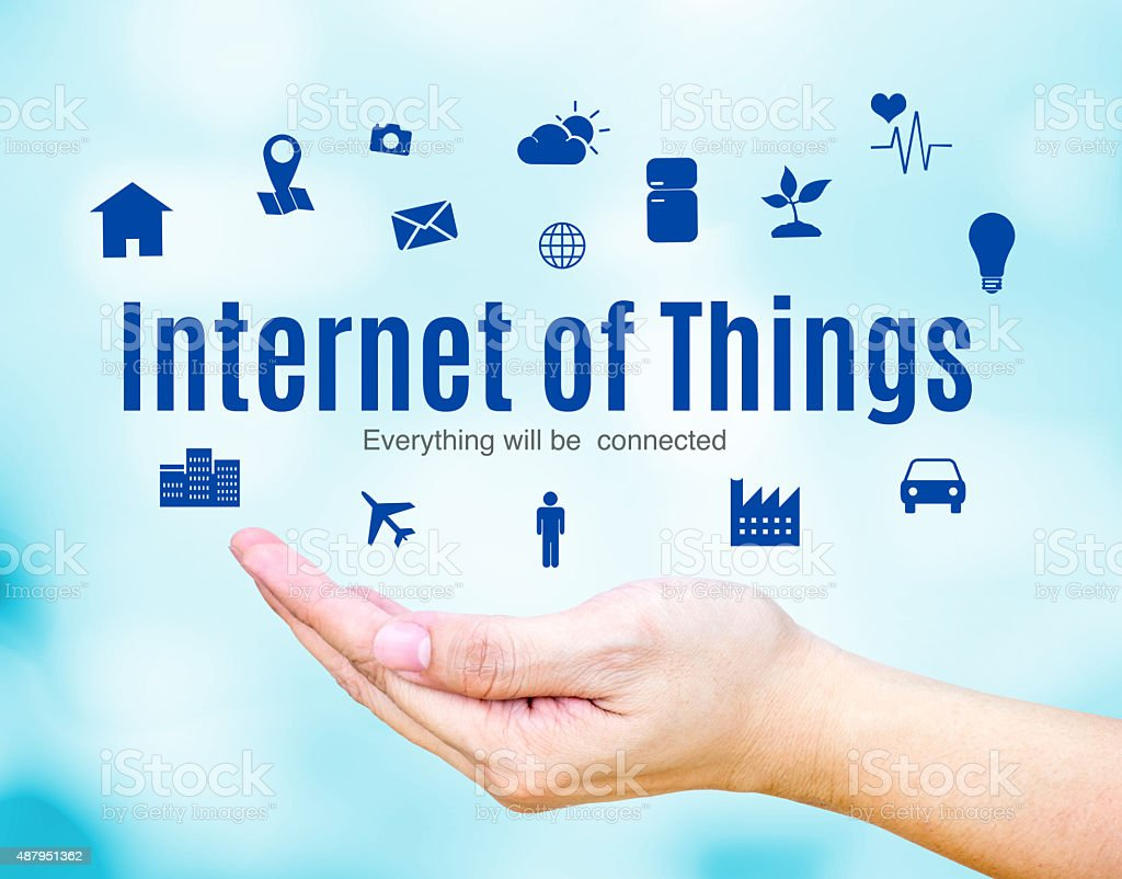 Open hand with Internet of Things (IoT) word and icon stock photo