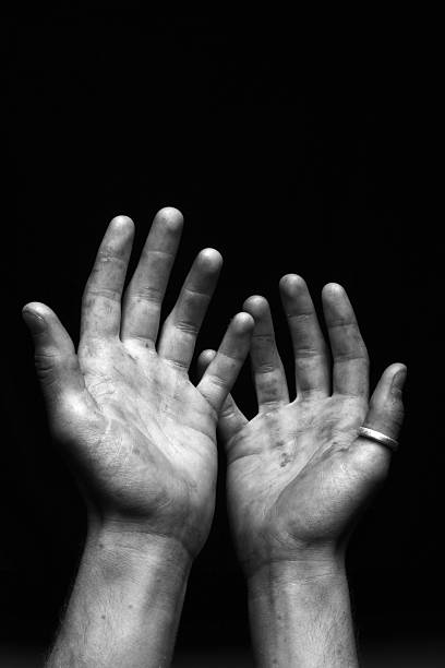 Open Hands - Dirty on Black stock photo