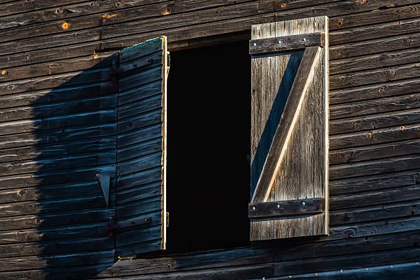 Open hatch on dark building stock photo