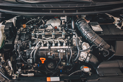Open hood on diesel engine modern car in detail