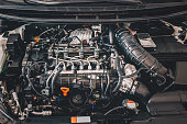 istock Open hood on diesel engine modern car in detail 1097603128