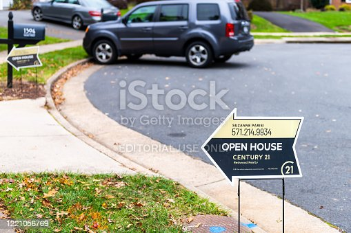 1081572480 istock photo Open house rsign in front of house street in Fairfax County, Virginia neighborhood Century 21 agent 1221056769