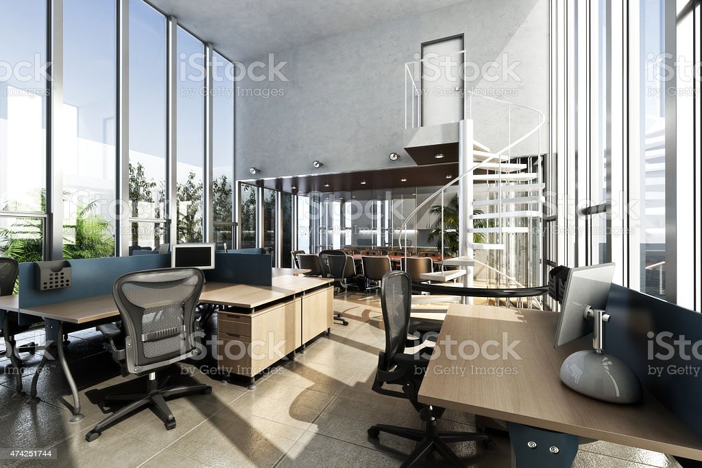 Open interior furnished modern office with large ceilings and windows...