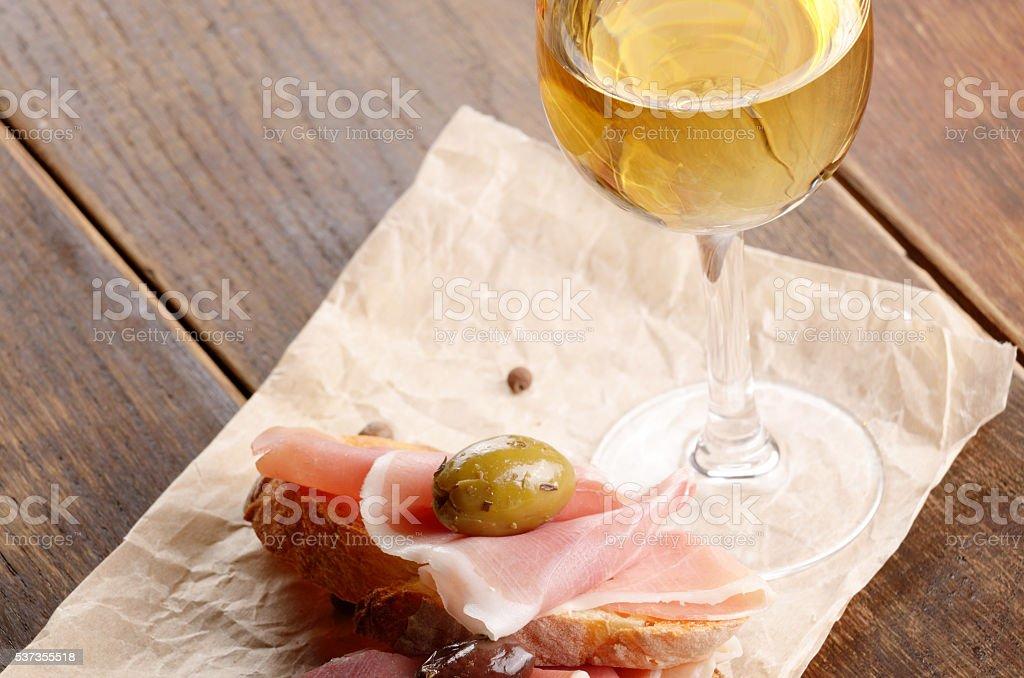 Open jamon sandwiches with white wine stock photo