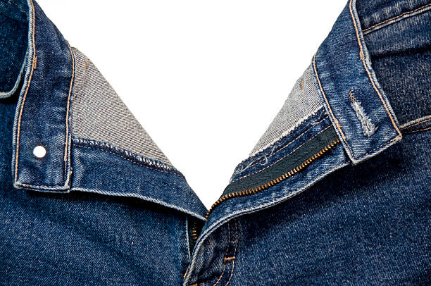 Open Jeans With Clipping Path A pair of jeans with the fly opened and clipping path. fully unbuttoned stock pictures, royalty-free photos & images