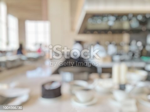 886308526istockphoto Open kitchen blur background in luxury hotel restaurant facility showing chef cooking over blurry food counter for buffet catering service 1004566730