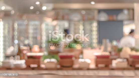 886308526istockphoto Open kitchen blur background in luxury hotel restaurant facility showing chef cooking over blurry food counter for buffet catering service 1097682610
