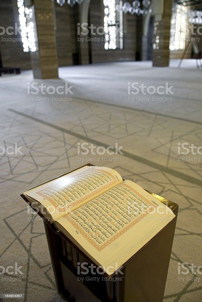 Open Koran in a mosque stock photo
