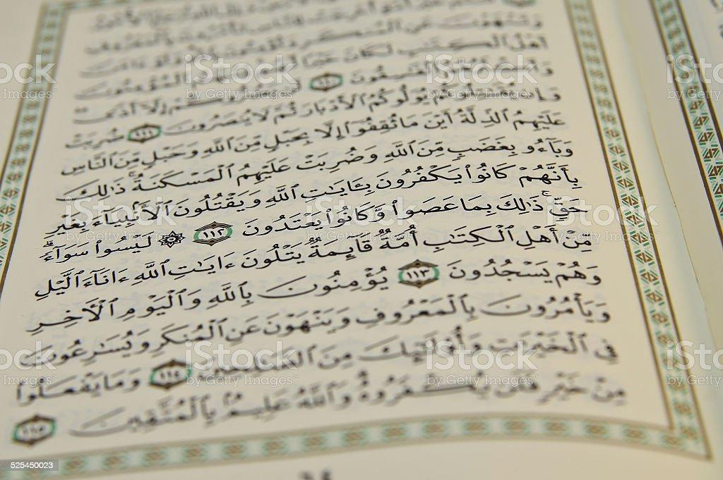 Open Koran with arabic writing visible stock photo