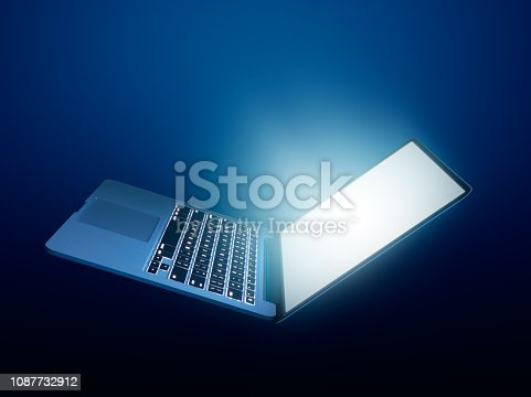istock Open laptop with glowing light on dark background 1087732912