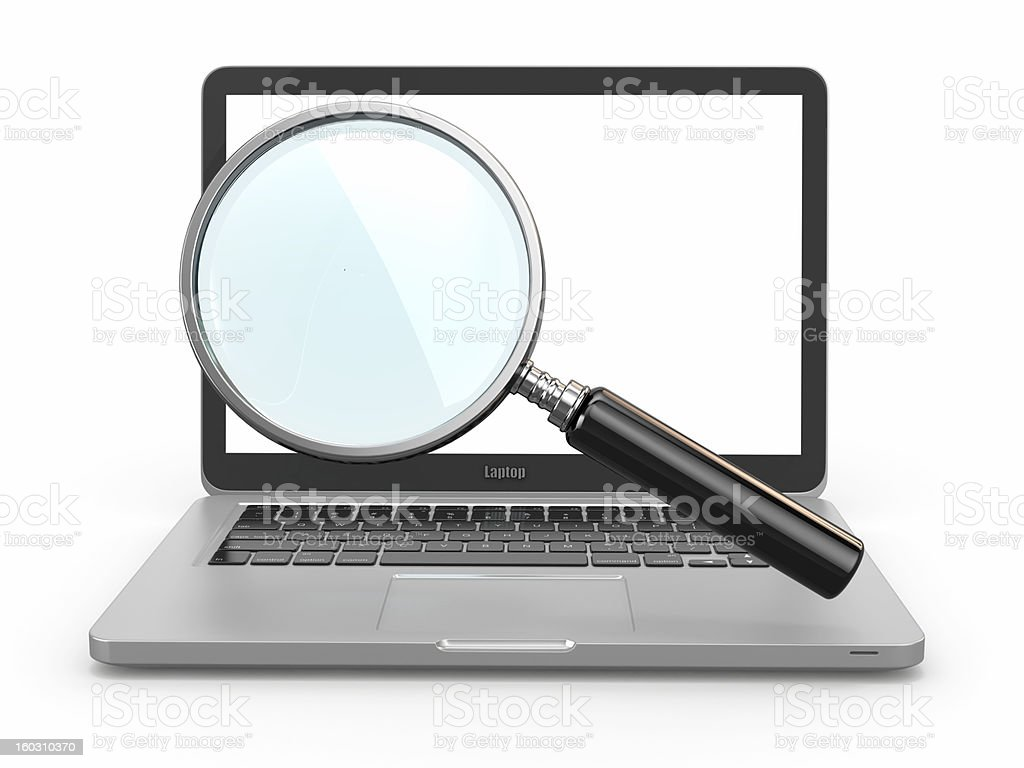 Open laptop with magnifying glass against screen royalty-free stock photo