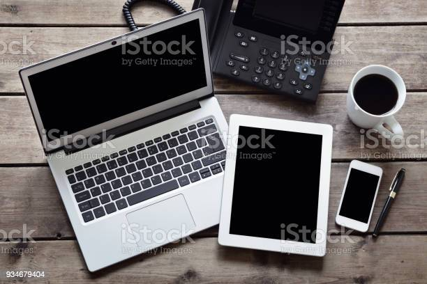 Open Laptop With White Digital Tablet And Smartphone On Desk From Above Stock Photo - Download Image Now