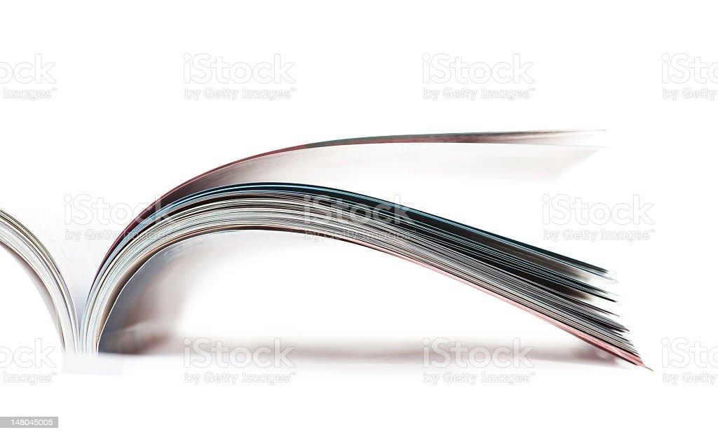 Open magazine on white background stock photo