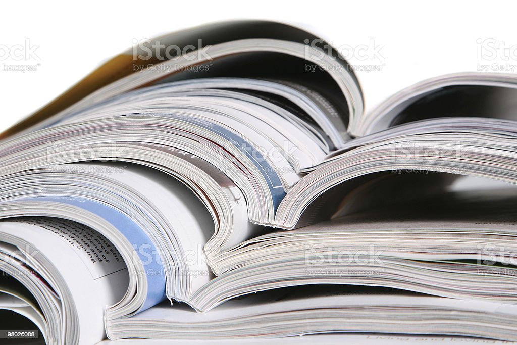 Open magazines isolated on white background royalty-free stock photo