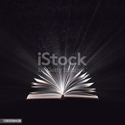 528363897 istock photo Open magic book, bewitched book glows in the darkness, magic light. Education. Dreamy image of a fairytale 1093599438