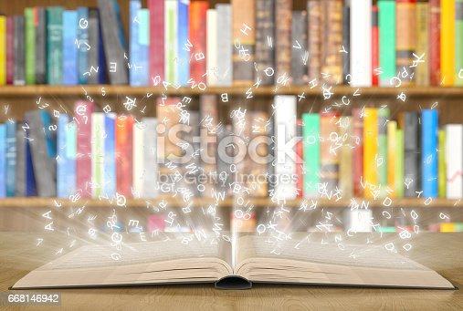 Open magic book with magic lights on a bookshelf