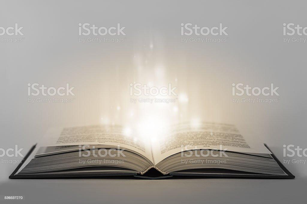 Open magical book stock photo