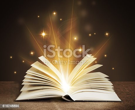 528363897istockphoto open magical book 616248894