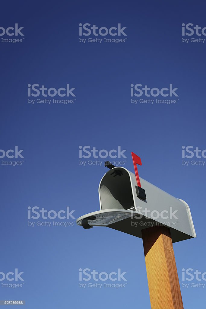 Open Mailbox with Blue Sky stock photo