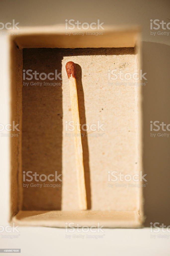 Open matchbox and last match stock photo
