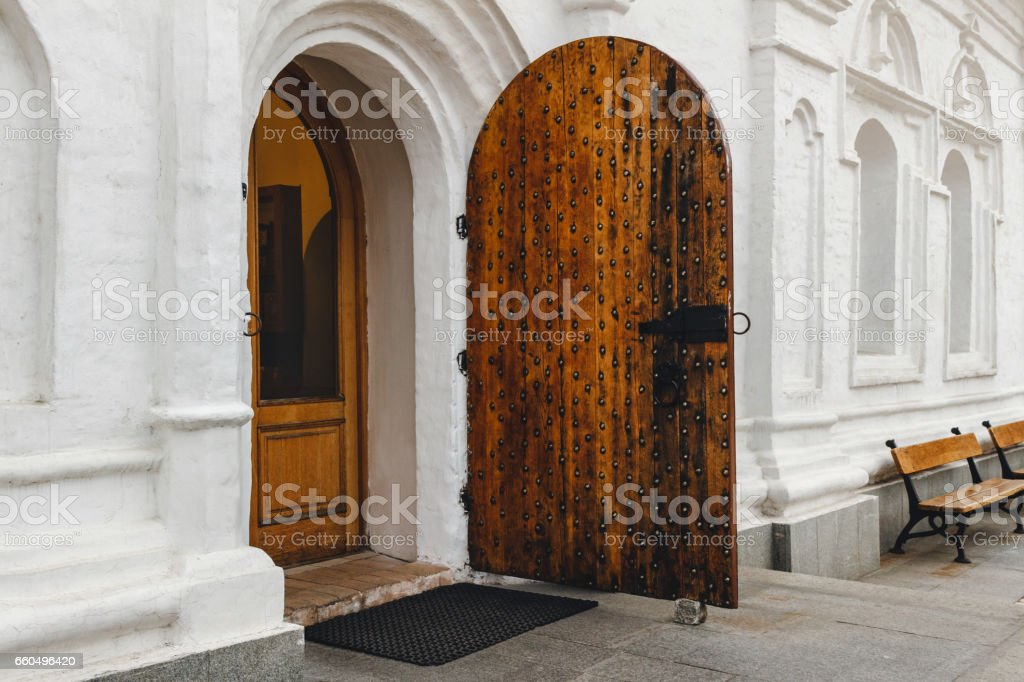 Open medieval door with metal decoration in white wall of old orthodox church. stock photo & Royalty Free Medieval Door Pictures Images and Stock Photos - iStock