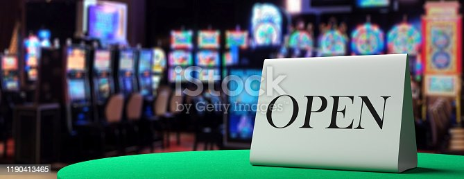 istock Open metal sign on a casino table, blur slot machines background. 3d illustration 1190413465