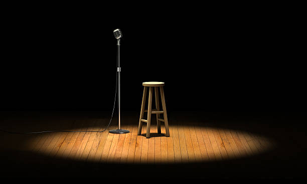 Open Mic Microphone stand and wooden stool under a spotlight on a stage stool stock pictures, royalty-free photos & images
