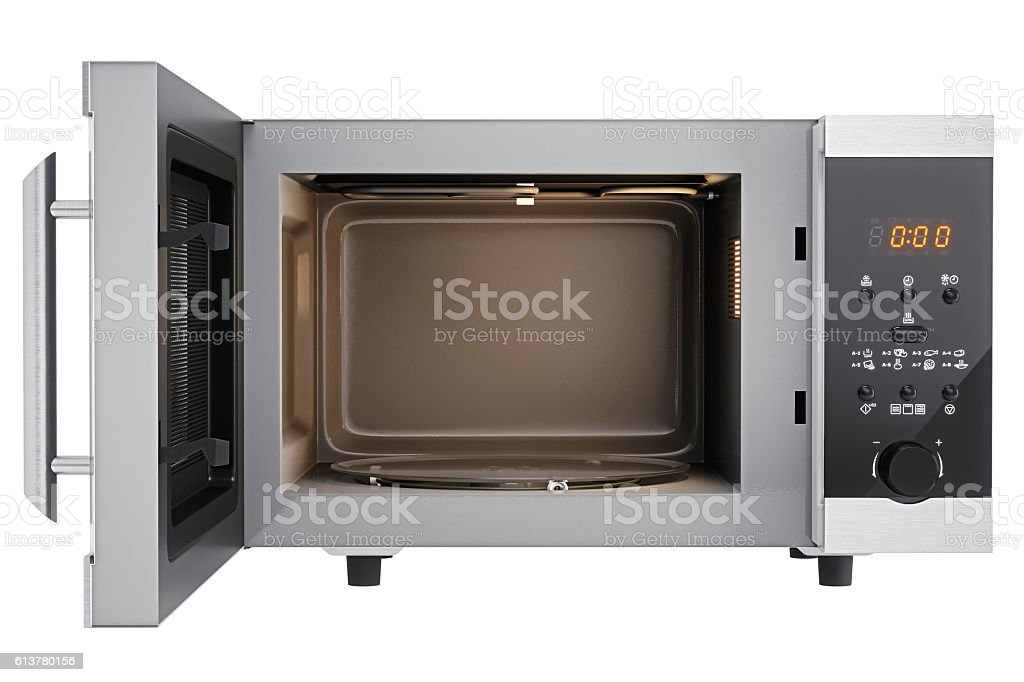 Open Microwave Oven Isolated On White stock photo